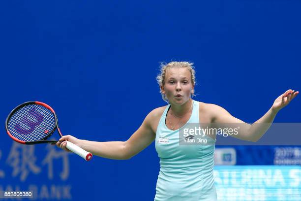 Katerina Siniakova reacts during the match against Kristina Mladenovic on Day 1 of 2017 Dongfeng Motor Wuhan Open at Optics Valley International...