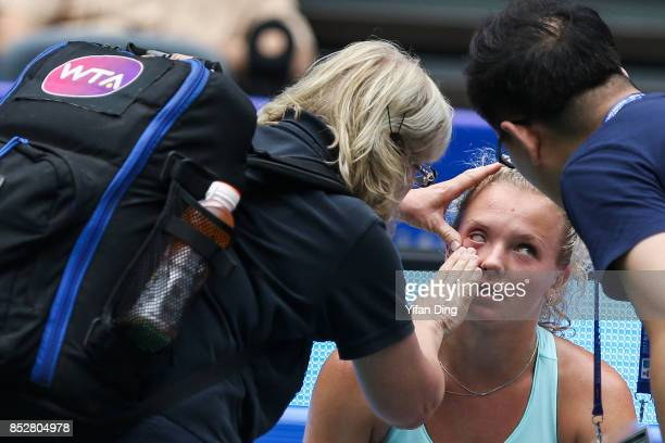 Katerina Siniakova receives medical treatment during the match against Kristina Mladenovic on Day 1 of 2017 Dongfeng Motor Wuhan Open at Optics...