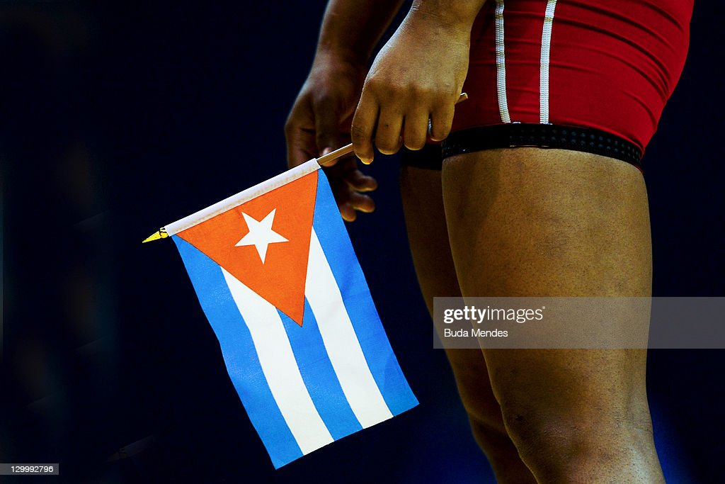 Katerina Vidiaux of Cuba, with the flag of her country before the Women's Freestyle 63 kg event during the Pan American Games Guadalajara 2011 at CODE Dome on October 22, 2011 in Guadalajara, Mexico.