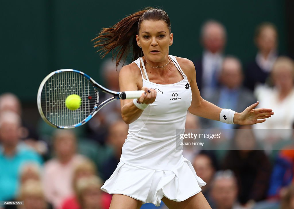 Kateryna Kozlova of Ukraine plays a forehand during the Ladies Singles second round match against Agnieszka Radawanska of Poland on day three of the Wimbledon Lawn Tennis Championships at the All England Lawn Tennis and Croquet Club on June 29, 2016 in London, England.