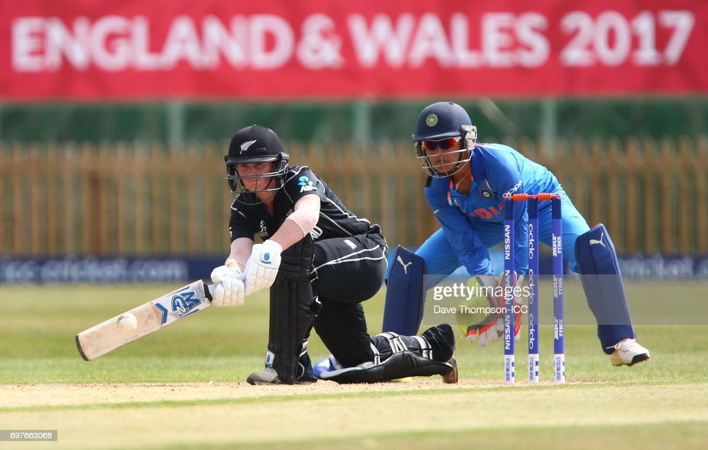 Katey Martin of New Zealand plays a shot in front of Sushma Verma of India during the ICC Women's World Cup warm up match between India and New Zealand at The County Ground on June 19, 2017 in Derby, England.