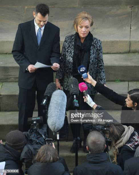 Kath Rathband ex wife of PC David Rathband stands next to her solicitor on the steps of the Moot Hall Newcastle as he reads out a statement after...