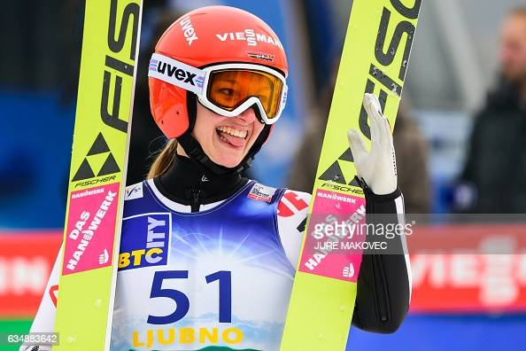 Katharina Althaus of Germany reacts after her jump during the Ladies FIS World Cup ski jumping competition in Ljubno Slovenia on February 12 2017 /...