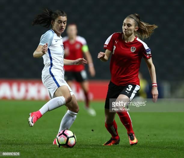Katharina Naschenweng of Austria Women looks to move past Karen Carney of England Women during the International Friendly match between England Women...