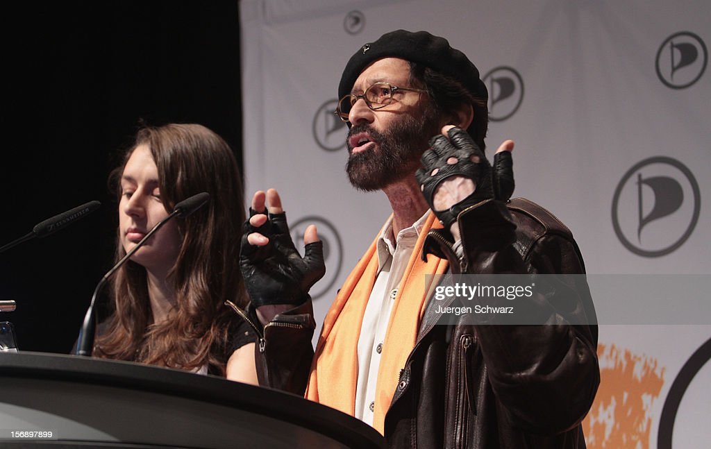 Katharina Nocum (L) and Meinhart Kriscke Ramaswamy attend the federal party convention of the German Pirates Party (Die Piratenpartei) on November 24, 2012 in Bochum, Germany. The Pirates, after riding an initial surge in popularity last year that landed them seats in several German state parliaments, have since seen their popularity erode as recent scandals and infighting have tarnished the party's image. Germany faces federal elections in 2013.