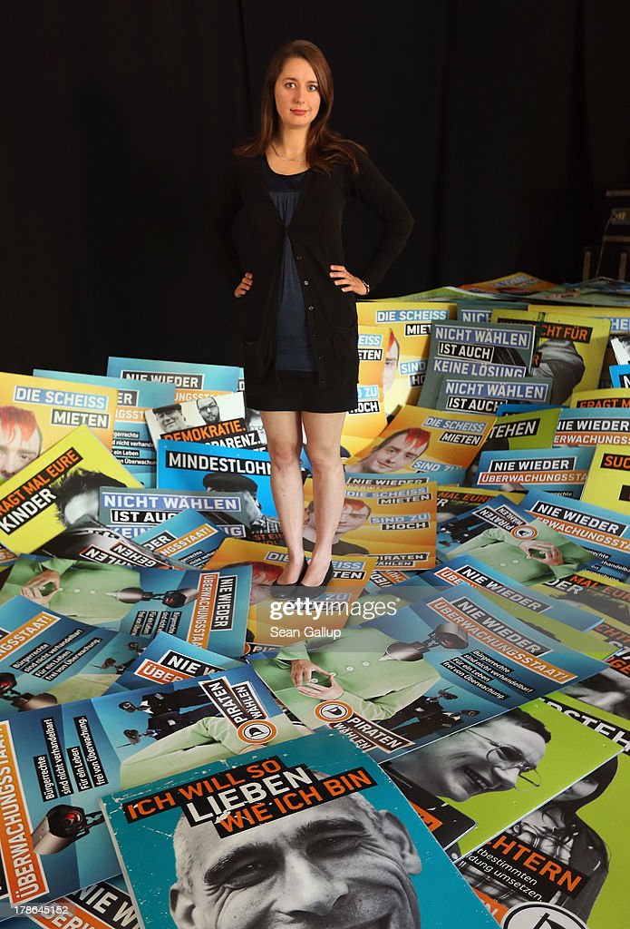 Katharina Nocun, leader of the German Pirates Party (Die Piraten) poses for a picture among election campaign posters at the Pirates' regional election campaign headquarters on August 30, 2013 in Berlin, Germany. Germany is scheduled to hold elections on September 22 and the Pirates, who last year rode a wave of popularity that won them seats in several state parliaments, have since faltered and are unlikely to win the 5% minimum needed to gain seats in the Bundestag.