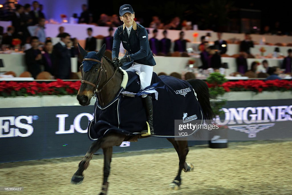 Katharina Offel of Ukraine acknowledges the crowd after winning the Longines Speed Challenge during the Longines Hong Kong Masters International Show Jumping at Asia World Expo on February 28, 2013 in Hong Kong, Hong Kong.