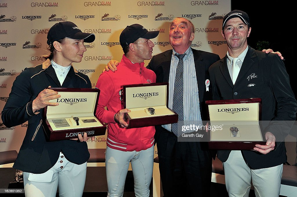 Katharina Offel of Ukraine (1st Place), Pius Schwizer of Switzeland (3rd Place) Walter Von Kanel President of Longines and Patrice Delaveau of France (2nd Place), pose with their awards during the Furusiyya FEI Nations Cup on February 28, 2013 in Hong Kong.