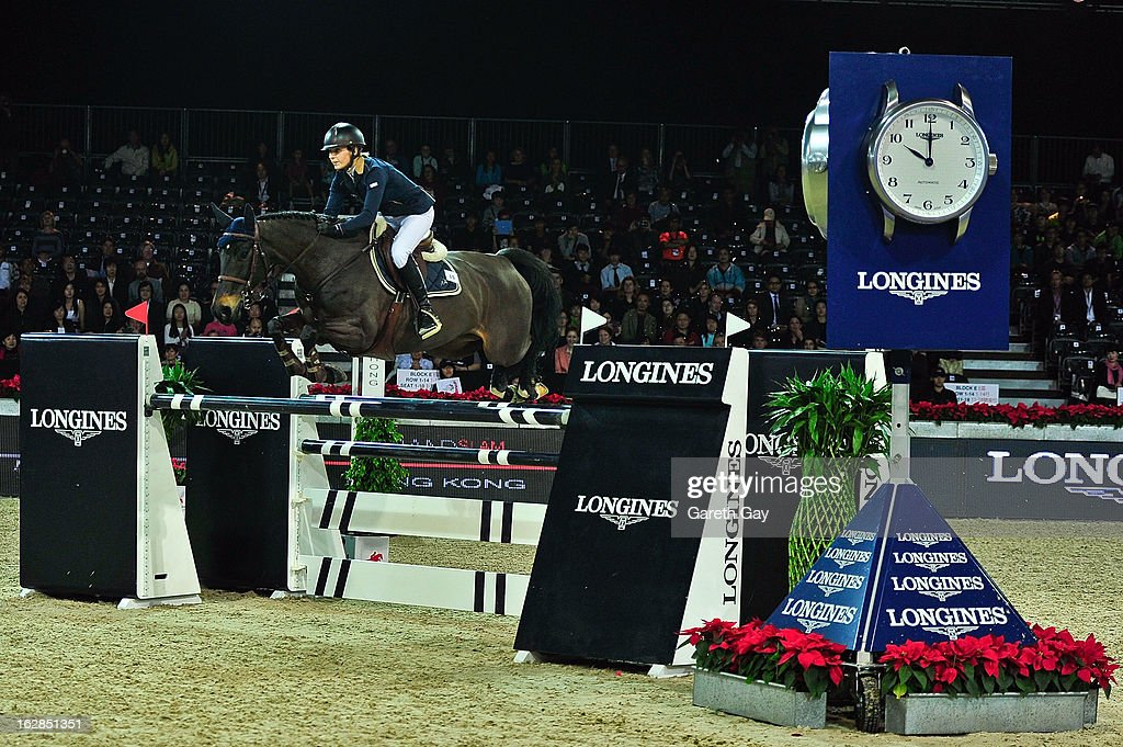 Katharina Offel of Ukraine rides Olivia de Nantuel during the Longines Speed Challenge during the Furusiyya FEI Nations Cup on February 28, 2013 in Hong Kong.