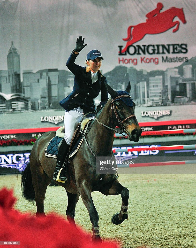 Katharina Offel of Ukraine riding Olivia de Nantuel waves to the crowd after winning the Longines Speed Challenge during the Furusiyya FEI Nations Cup on February 28, 2013 in Hong Kong.