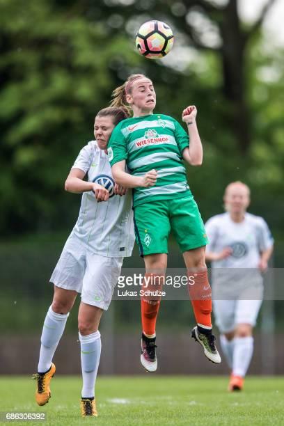Katharina Runge of Wolfsburg and Cindy Koenig of Bremen head the ball during the Second Bundesliga Nord match between Werder Bremen and VfL Wolfsburg...