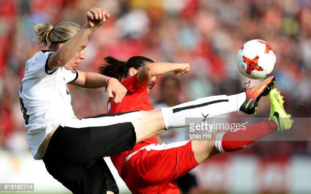 Katharina Schiechtl of Austria and Fabienne Humm of Switzerland compete for the ball during the Group C match between Austria and Switzerland during...