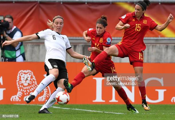 TOPSHOT Katharina Schiechtl of Austria vies with Vicky Losada and Silvia Meseguer of Spain during the UEFA Women's Euro 2017 quarterfinal football...