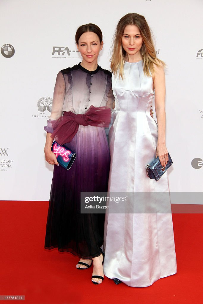Katharina Schuettler (L) and Nora von Waldstaetten arrive to the German Film Award 2015 Lola (Deutscher Filmpreis) at Messe Berlin on June 19, 2015 in Berlin, Germany.