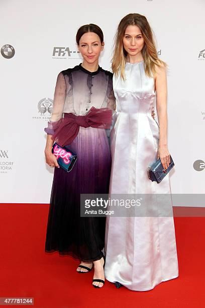Katharina Schuettler and Nora von Waldstaetten arrive to the German Film Award 2015 Lola at Messe Berlin on June 19 2015 in Berlin Germany