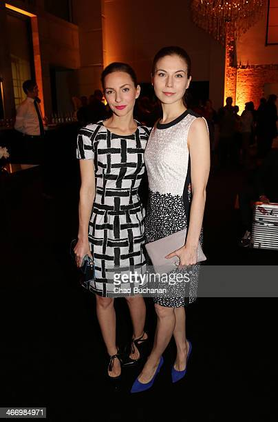 Katharina Schuettler and Nora von Waldsttten attend the Hugo Boss Exhibition 'A personal touch' on February 5 2014 in Berlin Germany