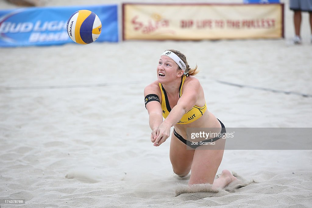 Katharina Schutzenhofer of Austria dives for the ball during the round of pool play at the ASICS World Series of Beach Volleyball - Day 3 on July 24, 2013 in Long Beach, California.