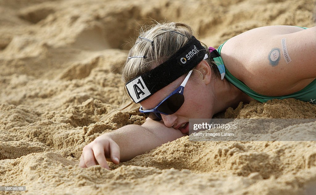 Katharina Schutzenhofer of Austria lies on the sand after missing a defense during a match between Colombia and Austria as part of day one of Corrientes Grand Slam of FIVB World Tour at Arazaty Beach on May 22, 2013 in Corrientes, Argentina.