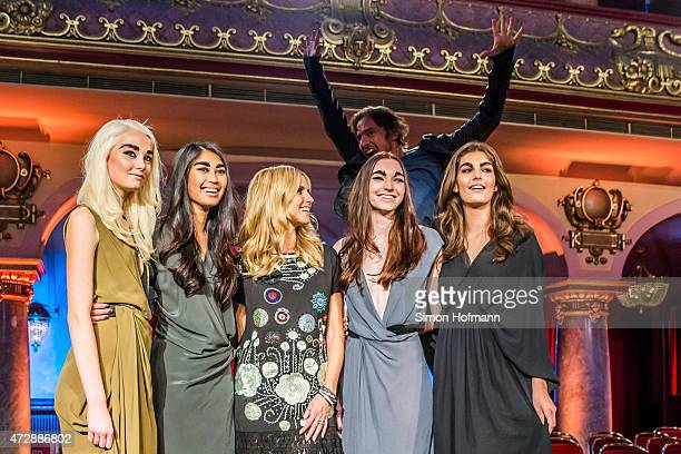 Katharina Wandrowsky Anuthida Ploypetch Heidi Klum Ajsa Selimovic and Vanessa Fuchs pose as Thomas Hayo jumps in the image during a photo call for...