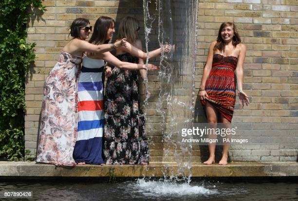 Katharine Crewe Read Hollie Mulvaney Hannah Duke 21 and Caitlin Pollock 21 all from Sussex enjoy the warm weather during Day Three of the 2010...