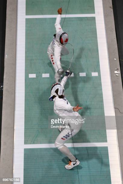 Katharine Holmes of the USA fences Malinka Hoppe Montanaro of Canada during the gold medal match of the Team Women's Epee event on June 16 2017 at...