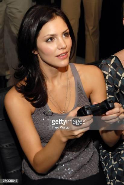 Katharine McPhee playing Playstation 3