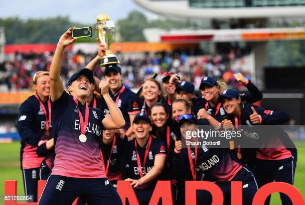 Katherine Brunt of England poses for a selfie with teammates after winning the ICC Women's World Cup 2017 Final between England and India at Lord's...
