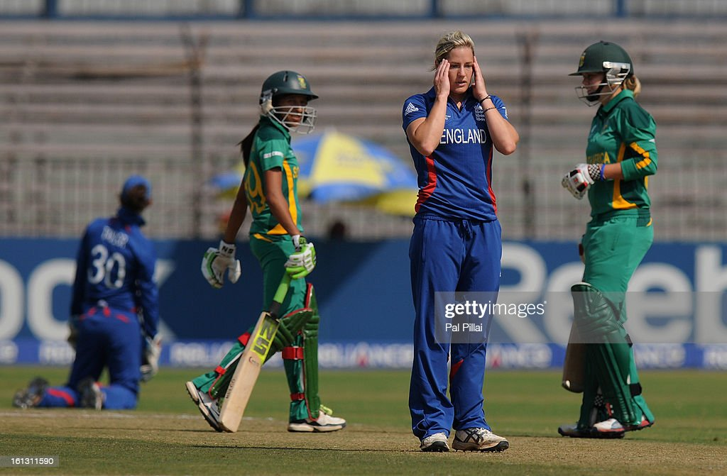 Katherine Brunt of England reacts after being hit for a boundary by Shabnim Ismail during the Super Sixes match between England and South Africa held at the Barabati stadium on February 10, 2013 in Cuttack, India.