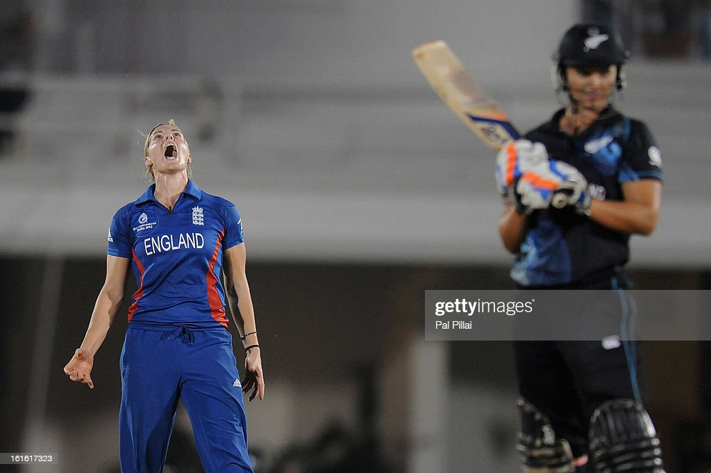 Katherine Brunt of England reacts after being hit for a boundary during the Super Sixes match between England and New Zealand held at the CCI (cricket club of India) on February 13, 2013 in Mumbai, India.