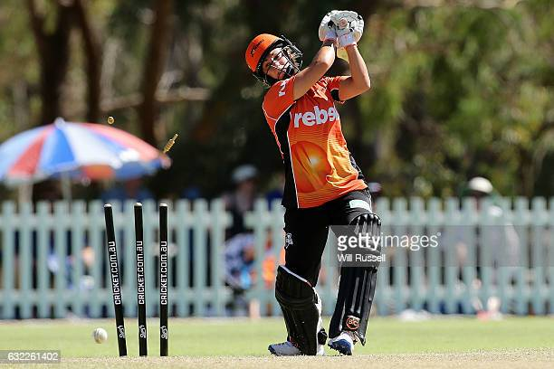 Katherine Brunt of the Scorchers is bowled by Nicola Carey of the Thunder during the Women's Big Bash League match between the Sydney Thunder and the...
