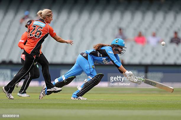 Katherine Brunt of the Scorchers throws the ball and runs out Alex Price of the Strikers during the WBBL match between the Strikers and Scorchers at...