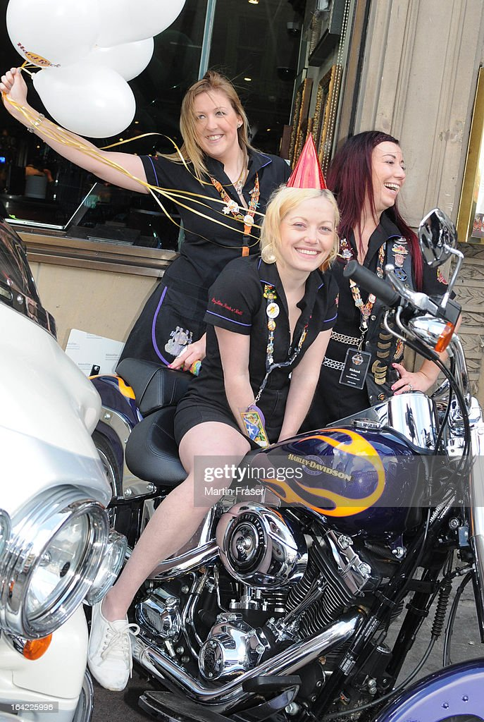 Katherine Chaplain joins other Hard Rock waitresses and a collection of classic Harley Davidson motorcycles to celebrate the 15th anniversary of The Hard Rock Cafe at Hard Rock Cafe on March 21, 2013 in Edinburgh, Scotland.