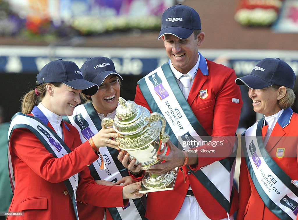 Katherine Dinan, <a gi-track='captionPersonalityLinkClicked' href=/galleries/search?phrase=Jessica+Springsteen+-+Equestrian&family=editorial&specificpeople=5635588 ng-click='$event.stopPropagation()'>Jessica Springsteen</a>, Charlie Jayne and Elizabeth Madden of the United States Equestrian team win the Furusiyya FEI Nations Cup at the Dublin Horse Show 2014 on August 8, 2014 in Dublin, Ireland.