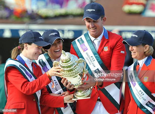 Katherine Dinan Jessica Springsteen Charlie Jayne and Elizabeth Madden of the United States Equestrian team win the Furusiyya FEI Nations Cup at the...