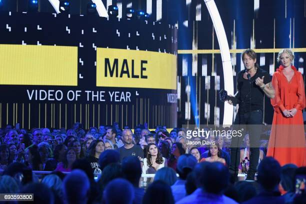 Katherine Heigl presents an award to Keith Urban onstage at the 2017 CMT Music Awards at the Music City Center on June 7 2017 in Nashville Tennessee