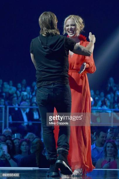 Katherine Heigl presents Keith Urban with an award during the 2017 CMT Music Awards at the Music City Center on June 6 2017 in Nashville Tennessee