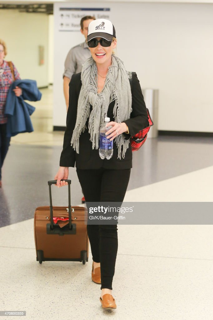 <a gi-track='captionPersonalityLinkClicked' href=/galleries/search?phrase=Katherine+Heigl&family=editorial&specificpeople=206952 ng-click='$event.stopPropagation()'>Katherine Heigl</a> seen at LAX airport on February 20, 2014 in Los Angeles, California.