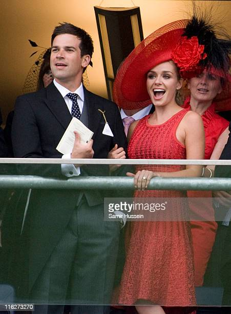 Katherine Jenkins and boyfriend Gethin Jones watch the racing on Day 2 of Royal Ascot at Ascot Racecourse on June 15 2011 in Ascot England