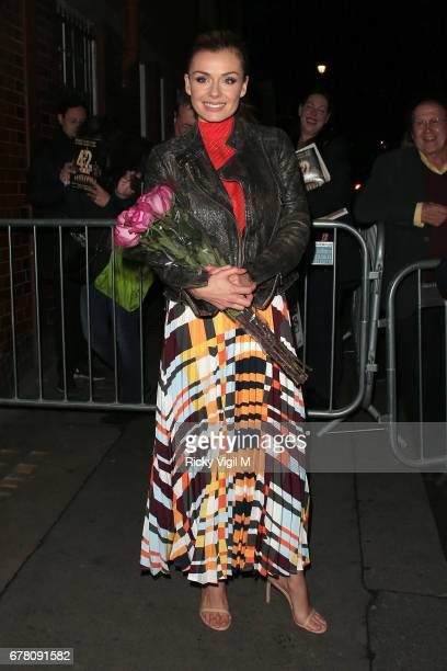 Katherine Jenkins receives a bunch of flowers from a fan as she leaves London Coliseum after her performance in 'Carousel' on May 3 2017 in London...