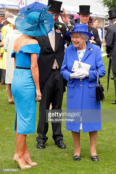 Katherine Jenkins talks with Queen Elizabeth II as they attend Derby Day at the Investec Derby Festival horse racing meeting at Epsom Racecourse on...