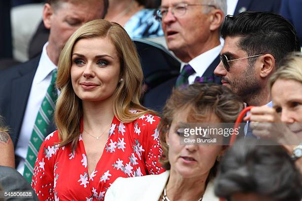 Katherine Jenkins watches on as Roger Federer of Switzerland plays Milos Raonic of Canada in the Men's Singles Semi Final match on day eleven of the...