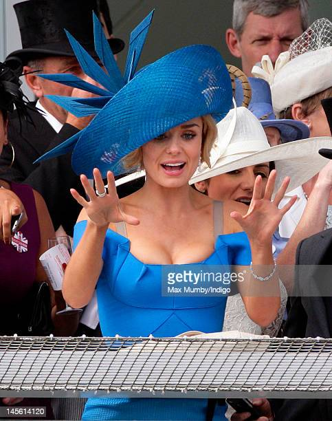 Katherine Jenkins watches the racing on Derby Day at the Investec Derby Festival horse racing meeting at Epsom Racecourse on June 2 2012 in Epsom...