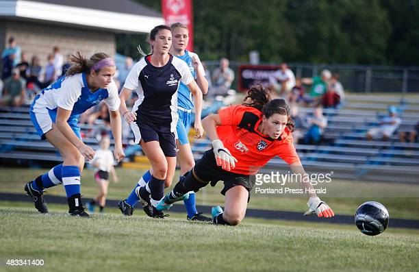 Katherine Kirk of Scarborough left and Samantha Robinson of York watch with WMC goalie Julianna Harwood of Waynflete as the ball kicked by Kirk rolls...