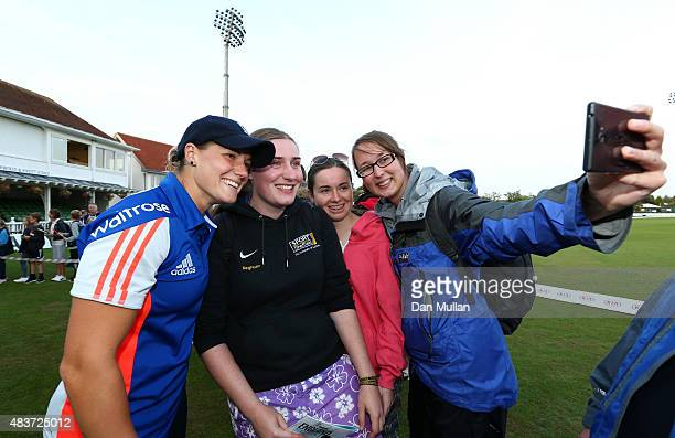 Katherine Knight of England poses for a selfie with fans following the close of play on day two of the Kia Women's Test of the Women's Ashes Series...