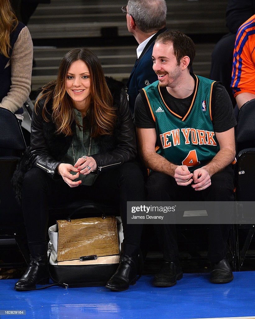 Katherine McPhee and guest attend the Golden State Warriors vs New York Knicks game at Madison Square Garden on February 27, 2013 in New York City.