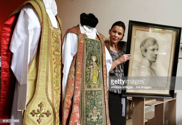 Katherine Milby views two vestments once owned by Cardinal Newman and a drawing of him on display at Sir Walter Scott's Abbotsford home in Melrose...