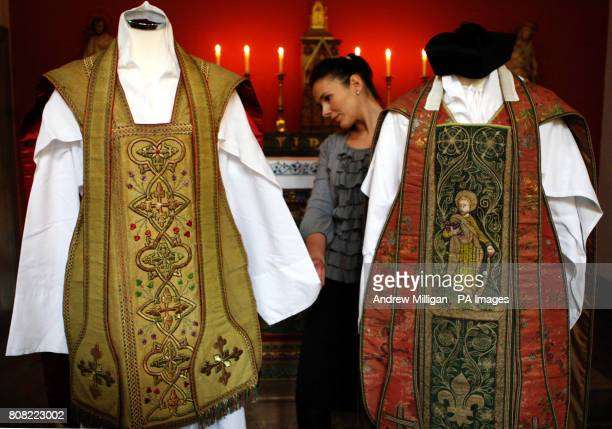 Katherine Milby views two vestments once owned by Cardinal Newman on display at Sir Walter Scott's Abbotsford home in Melrose Scottish Borders The...