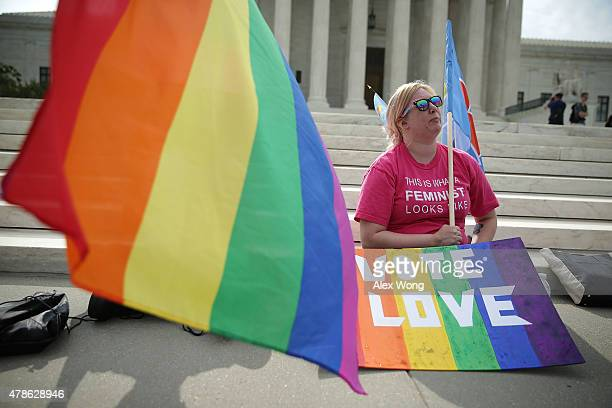 Katherine Nicole Struck of Frederick Maryland holds a rainbow sign in support of samesex marriage outside the US Supreme Court June 26 2015 in...