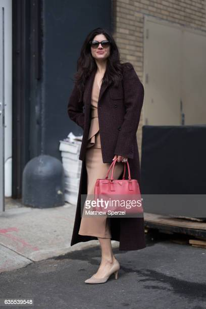 Katherine Parr is seen attending Vivienne Tam during New York Fashion Week while wearing a Zeena Zakri dress Mason Martin Margiela coat and red Prada...