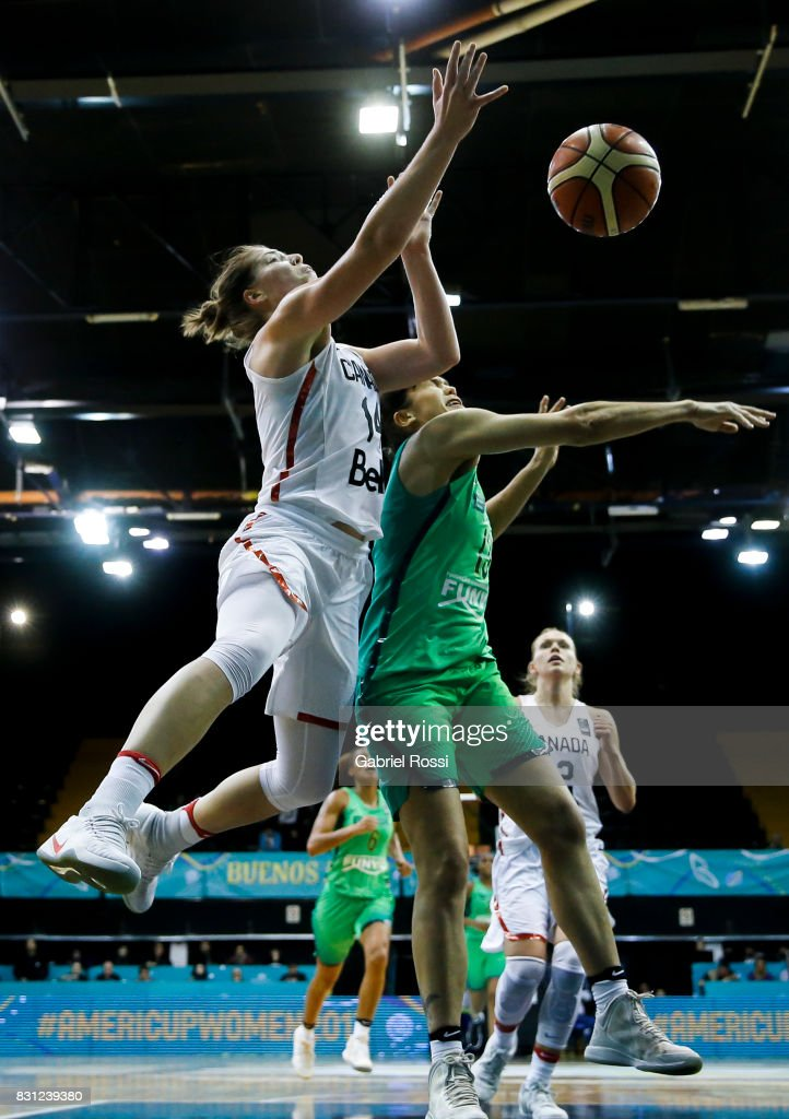 Katherine Plouffe of Canada (L) fights for the ball with Soeli Zakrzeski of Brazil during a match between Canada and Brazil as part of the FIBA Women's AmeriCup Semi Final at Obras Sanitarias Stadium on August 12, 2017 in Buenos Aires, Argentina.